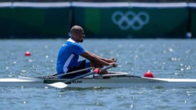 صورة الرشيدي ودشتي يحملان علم الكويت في افتتاح أولمبياد طوكيو